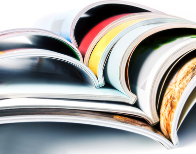stack of the colorful magazines